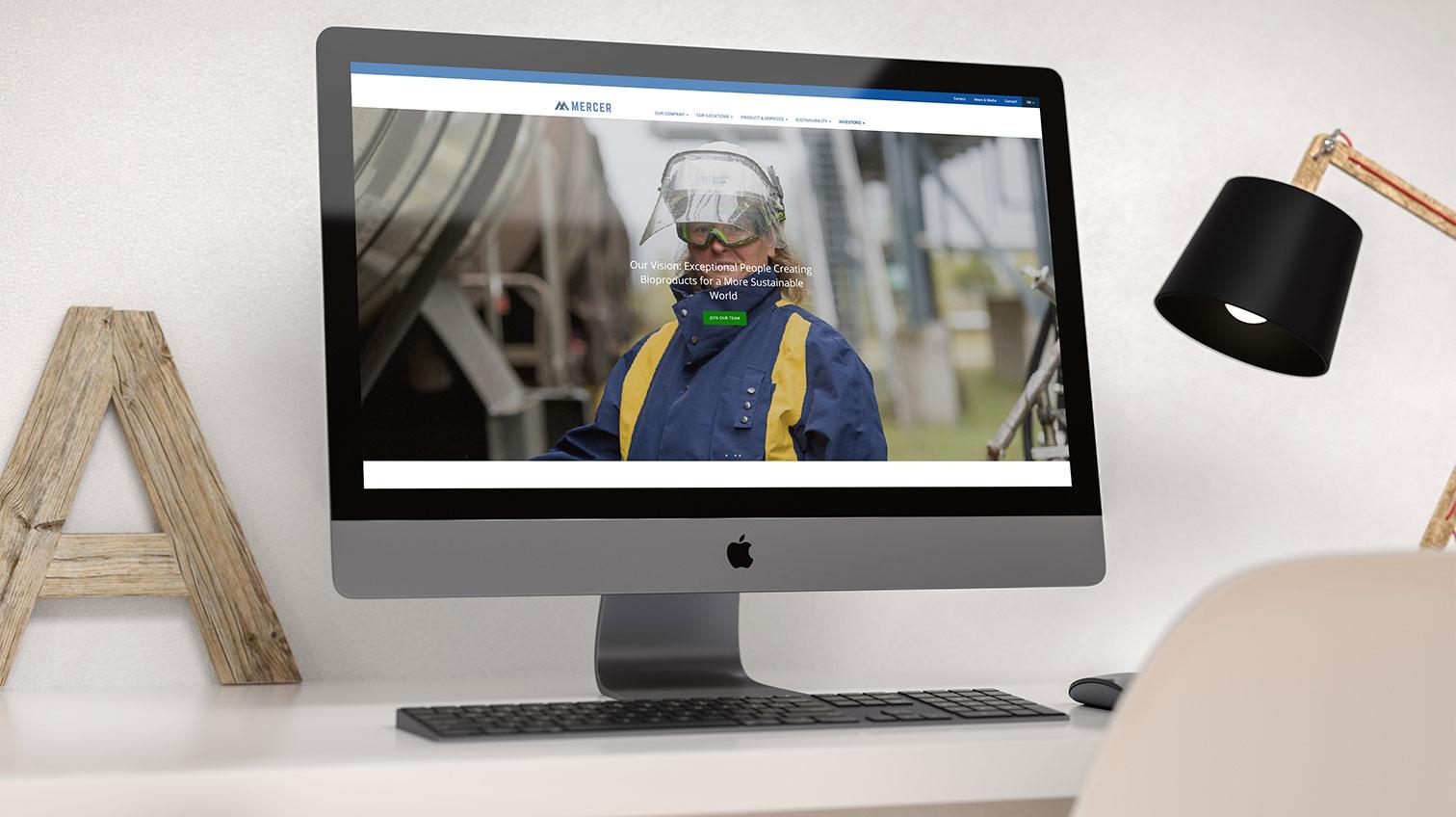 Mercer website shown on a desktop computer - White canvas design