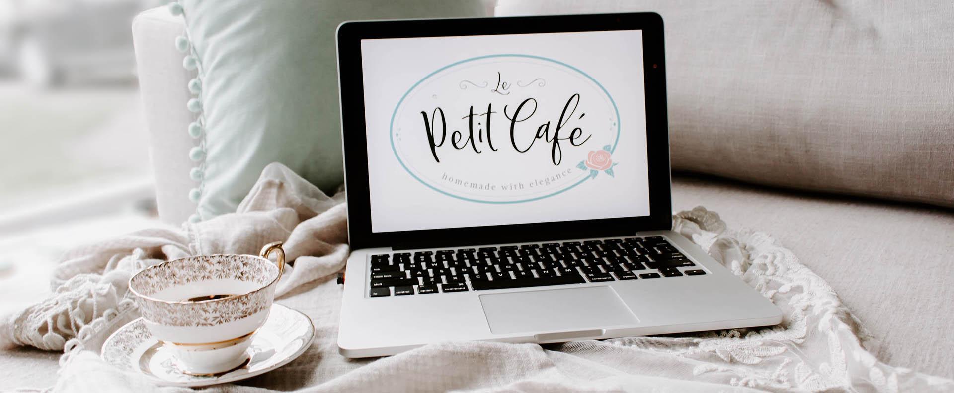 Le Petit Cafe logo shown on a laptop - White Canvas Design
