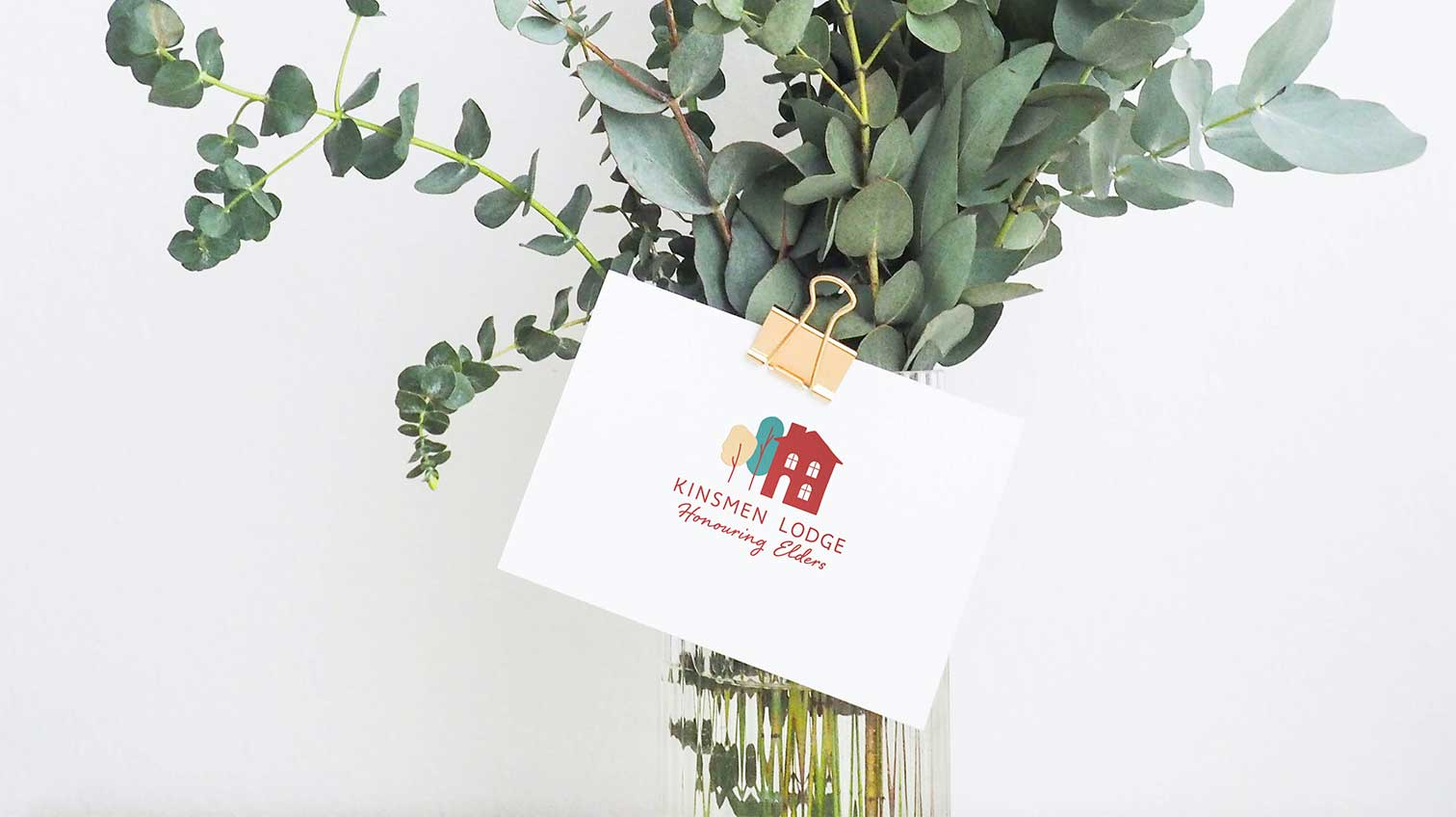Kinsmen lodge card attached to a vase of plants - White Canvas Design