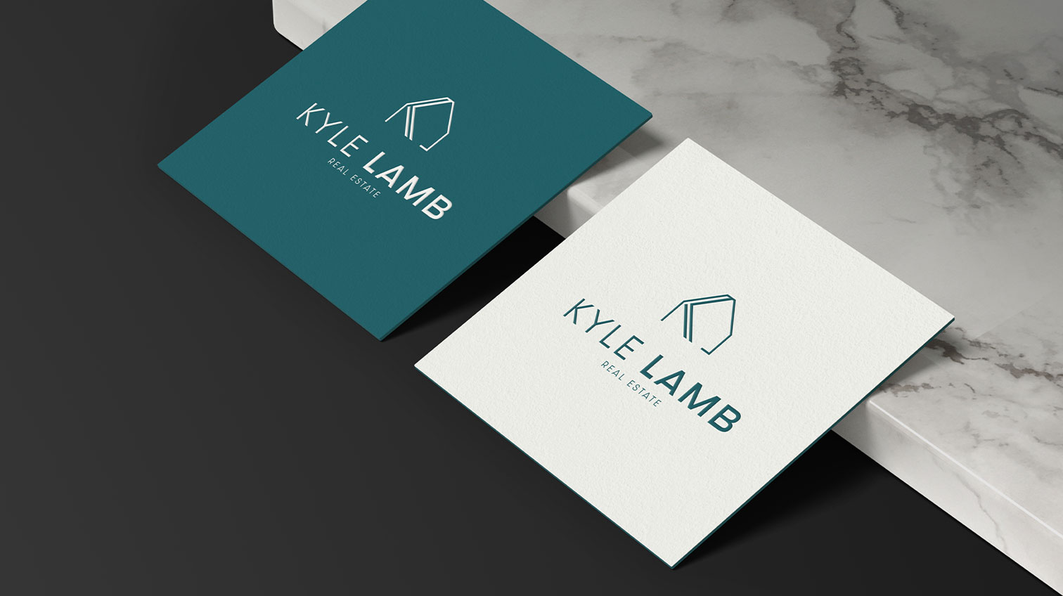 Kyle Lamb logo on white and blue paper - White canvas design