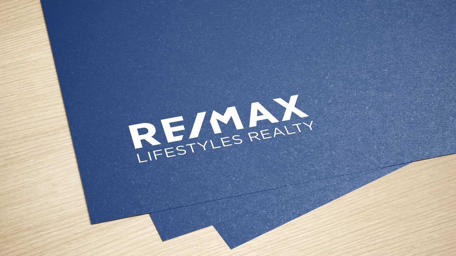 RE/MAX logo on blue paper - White Canvas Design